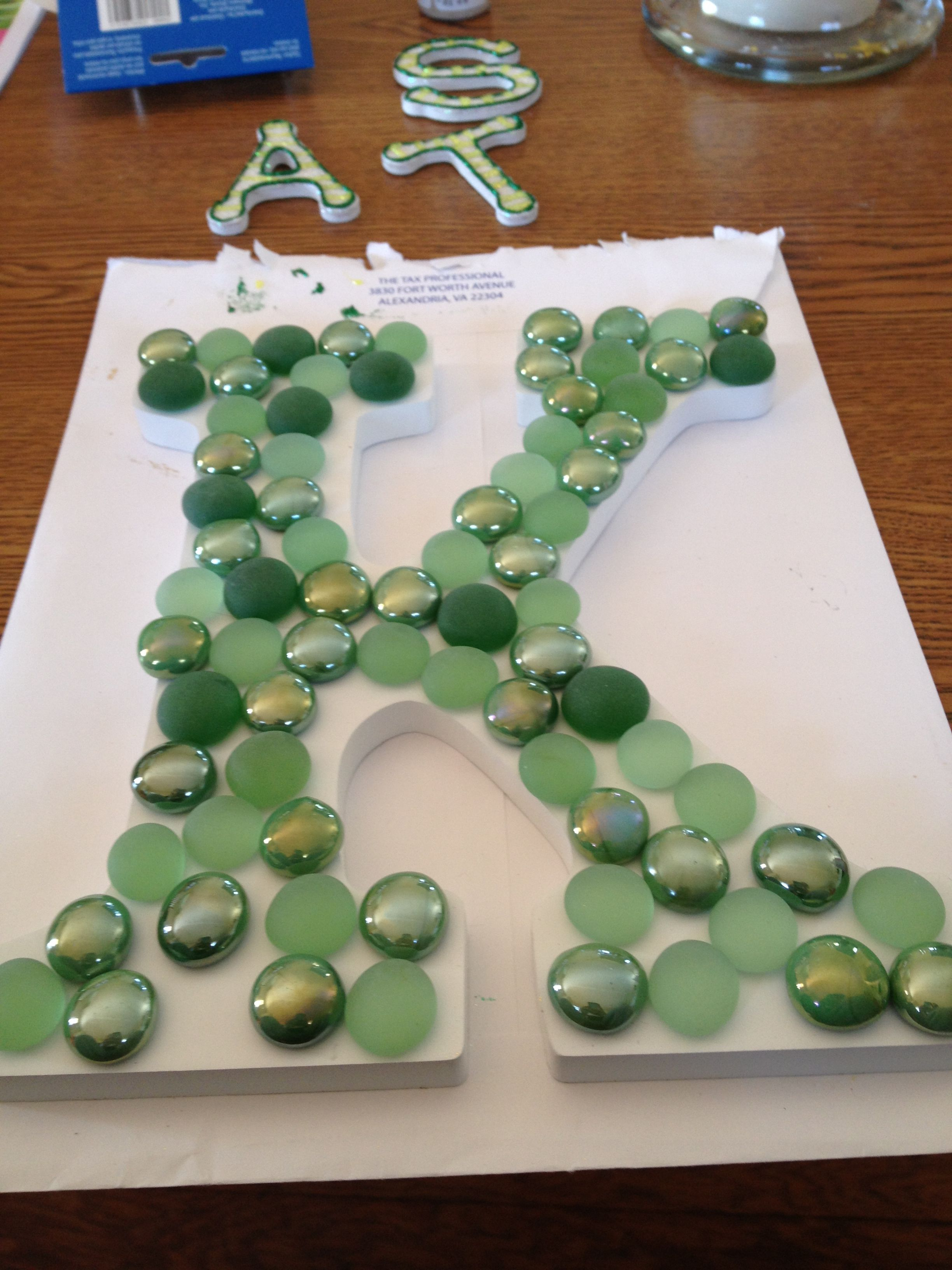 Letter, glue and glass gems makes for a great decoration ...
