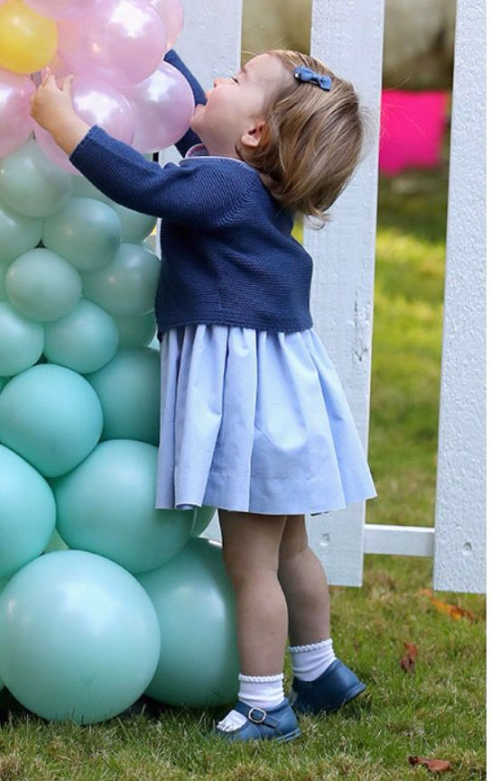 Princess Charlotte is enthusiastic about the balloons at the entrance to the Garden Party for children held on the grounds of the Governor's House in Vancouver, Canada. September 29, 2016.