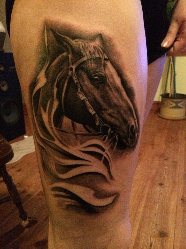 My sister's horse on her thigh! Tattoo by Charles Saucier