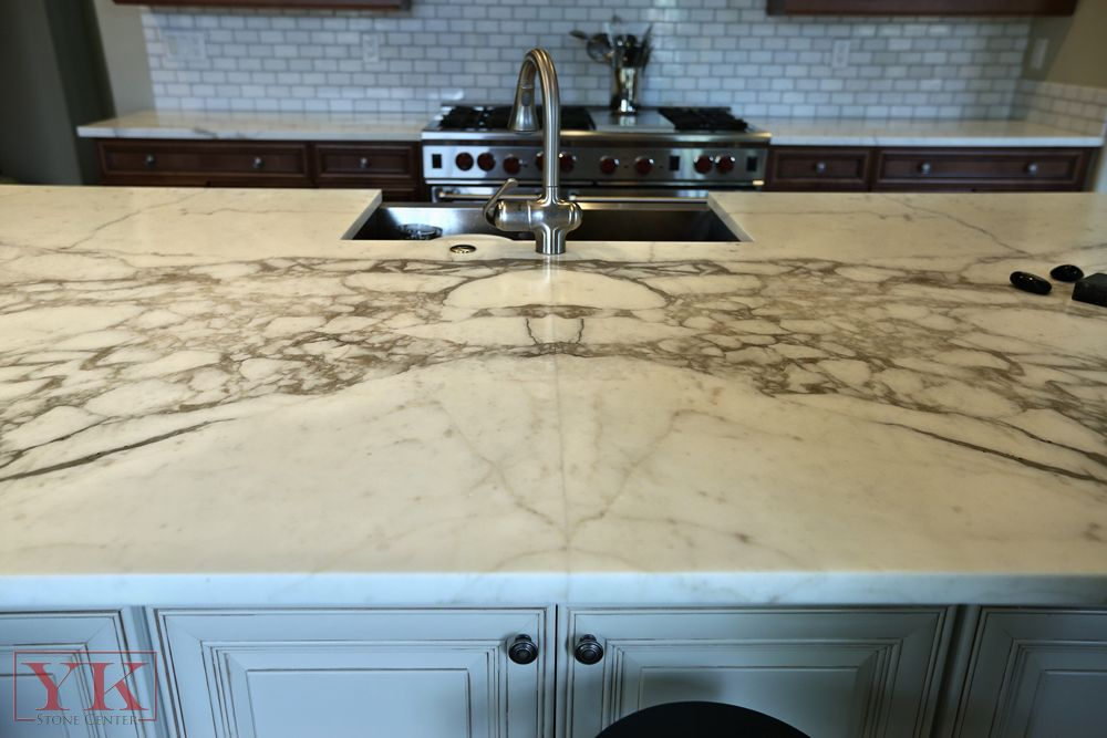 Closeup Of Book Matched Seam On Kitchen Island Courtesy Of Yk Stone Center Bright White