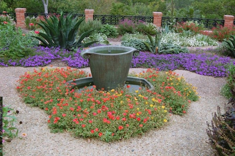 beautiful home gardens with fountains purple flowers railing red