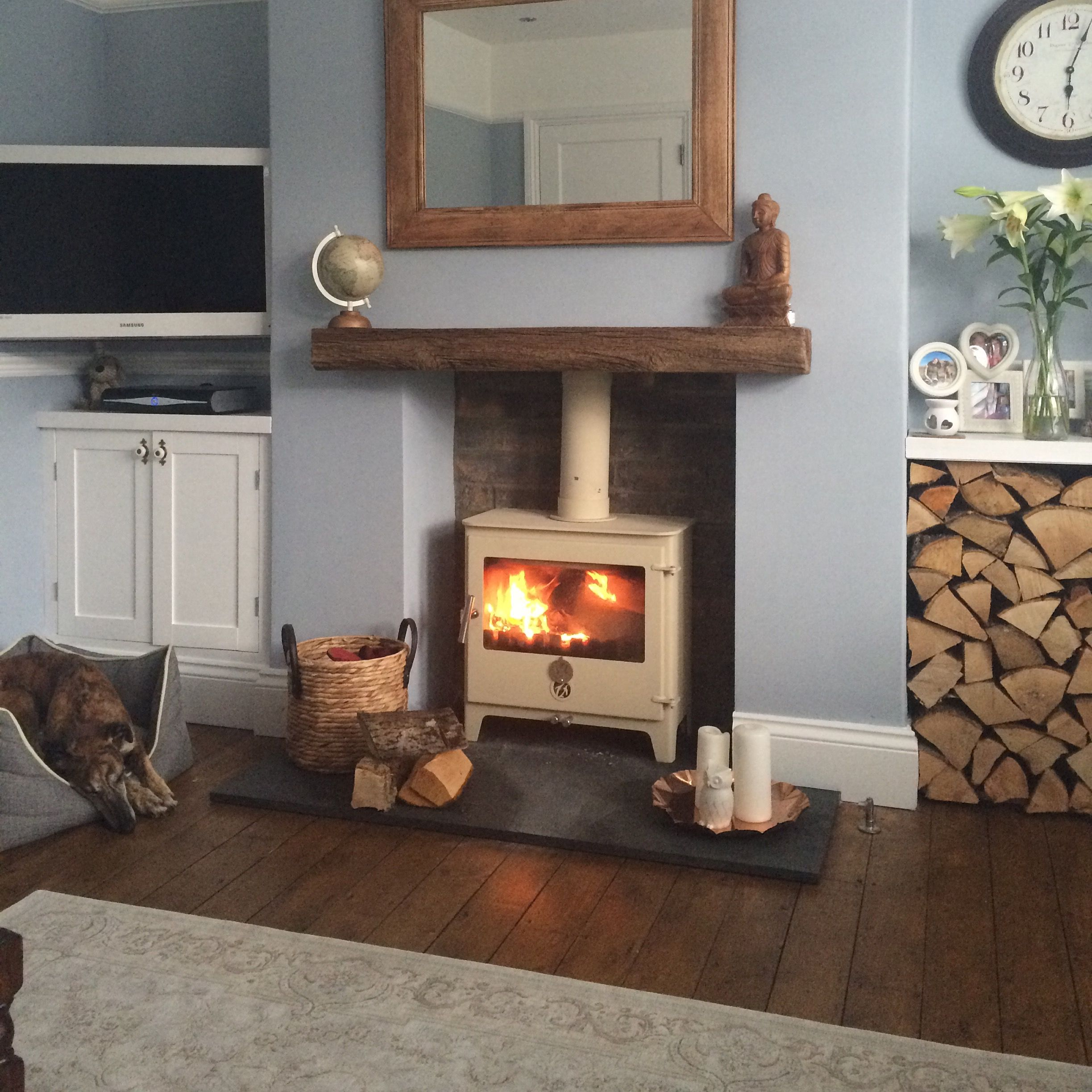 Living Room With Log Burner 5x7 Area Rug In Cozy Chilli Penguin Slate Harth Varnished Floorboards Blue Grey Walls