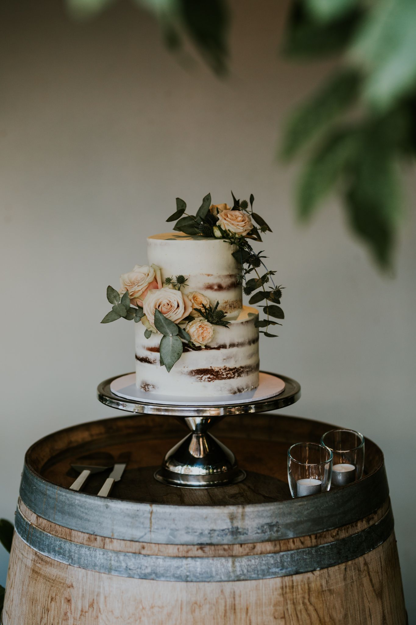 Rustic elegance combining roses, sea holly and eucalyptus