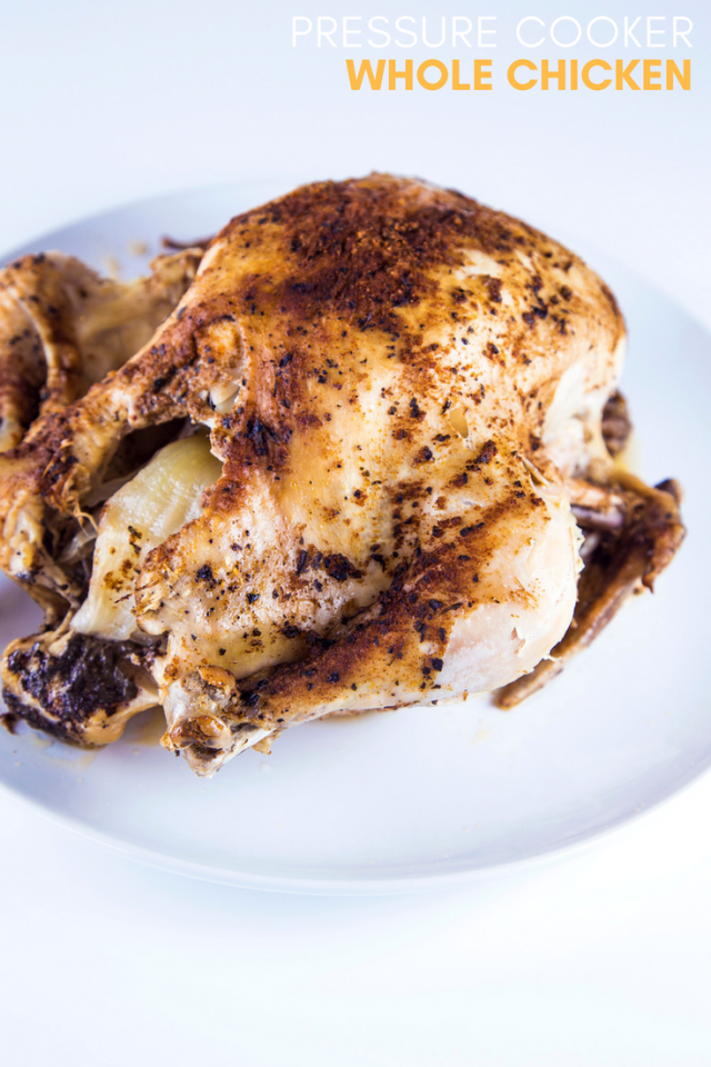 A Whole Chicken Covered With Olive Oil And Flavorful Spices Stuffed With Onion And Garlic Then