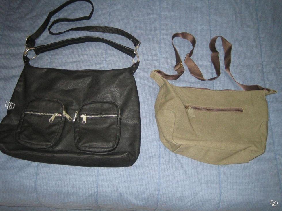 Myytävänä ylimääräiseksi jääneitä olkalaukkuja.Vasemmanpuoleinen musta laukku käyttämätön ja vedenpitävää tekonahkaa.Koko 47x34.Ulkona ja sisällä useita taskuja.Mahtuu A4 kansio. Hinta 10e.Vihreä kangaslaukku kerran ollut käytössä.Sisällä ja ulkona t