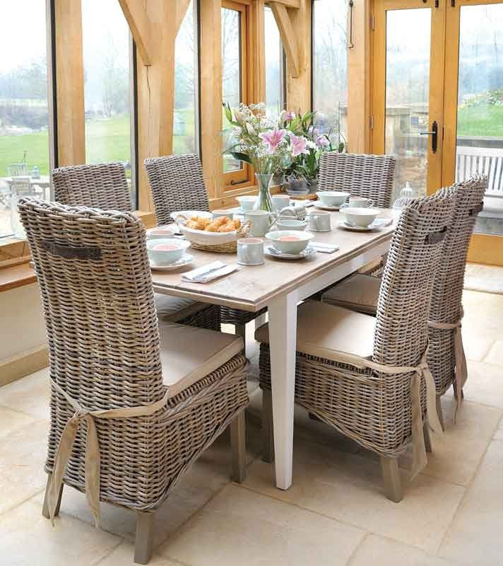 Wicker Chairs Around Square Table