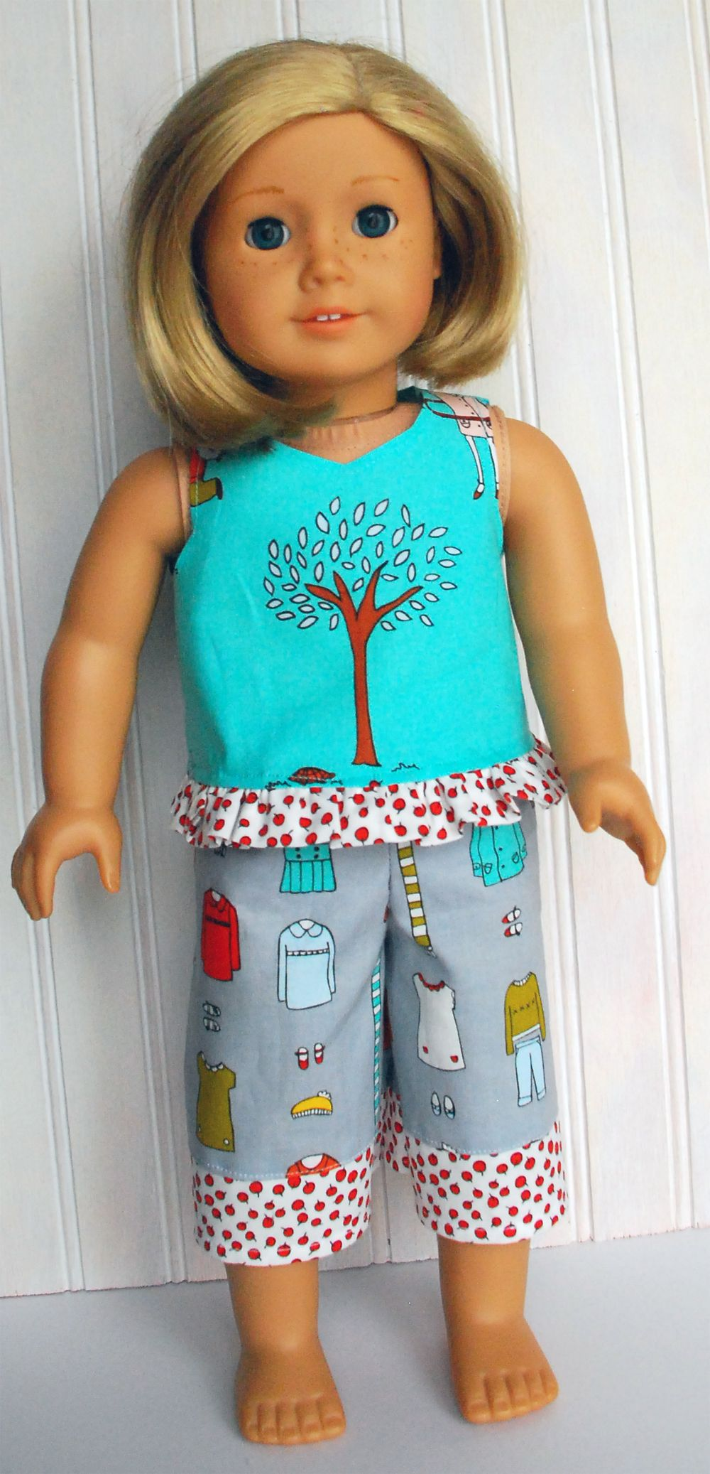 "Free ruffled tank top pattern for 18"" American Girl doll - uses 1 fat quarter, plus a strip of contrast fabric for the ruffle"