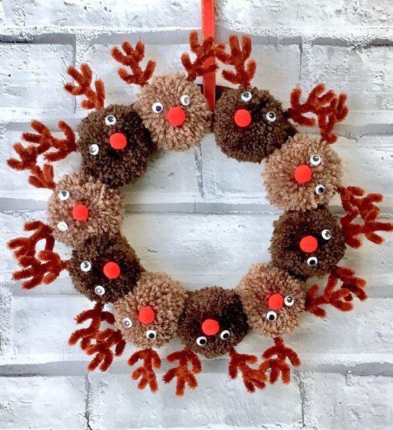 Photo of Handmade Christmas reindeer pom pom wreath
