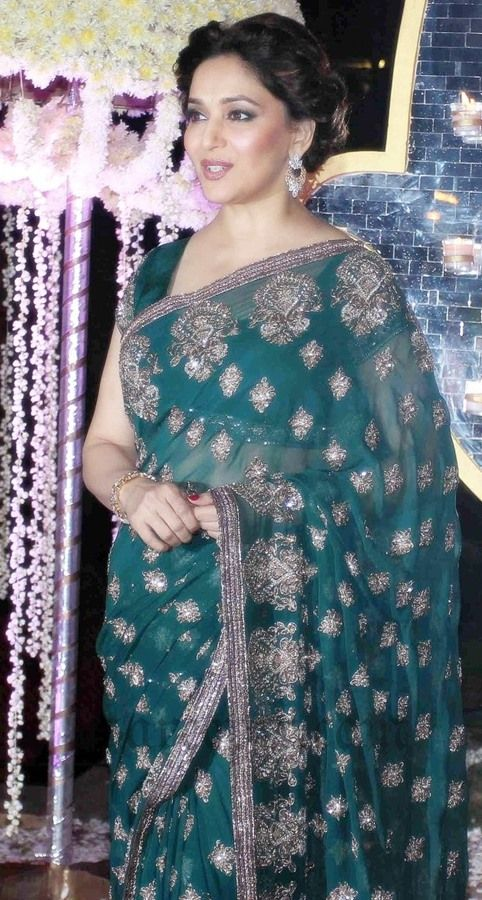 Ageless beauty Madhuri dixit in Manish malhotra green embroidery saree with matching blouse at Riddhi malhotra-Tejas wedding reception party in Mumbai.