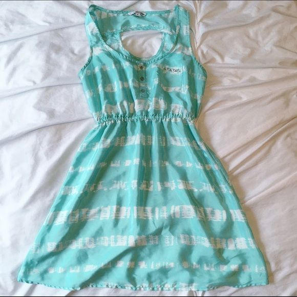 Summer Dress This is a super cute dress that has only been worn a couple times! I got it while I was in Europe, and unfortunately it no longer fits me. It's a size 36 European, which is a size 6 American. It's a dark mint color with white stripes and an elastic band around the waist. It has a cut out in the back and is perfect for summer or spring with a cardigan! Dresses Mini