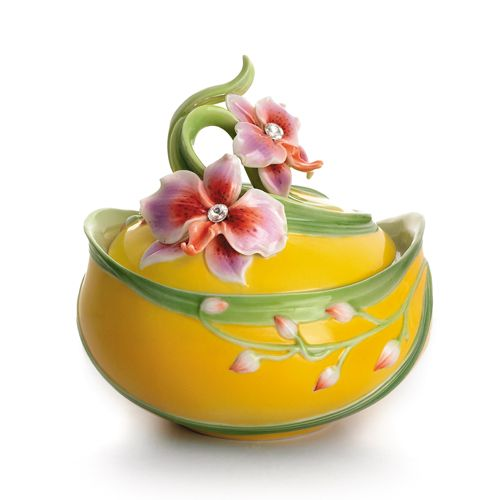 Our vibrant Moth Orchid Lidded Box from Franz Porcelain's Flowering Gems Collection celebrates the sensual beauty of an exotic living symbol of passion and vitality.