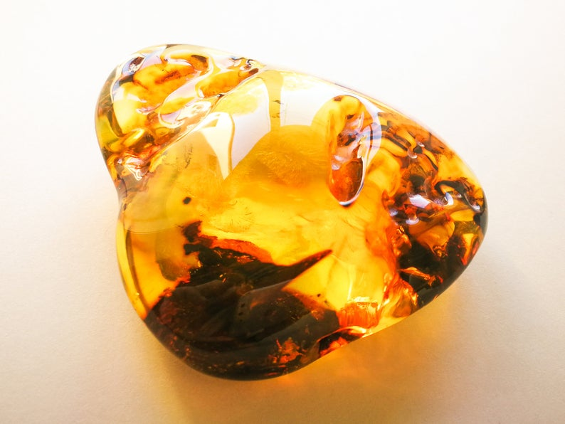 Exclusive amber stone with skin souvenir memento huge cognac color amber spiritual gift home Clear and shiny golden amber stone decoration