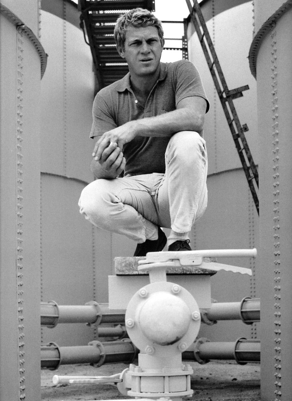 A young Steve McQueen wearing a tight polo