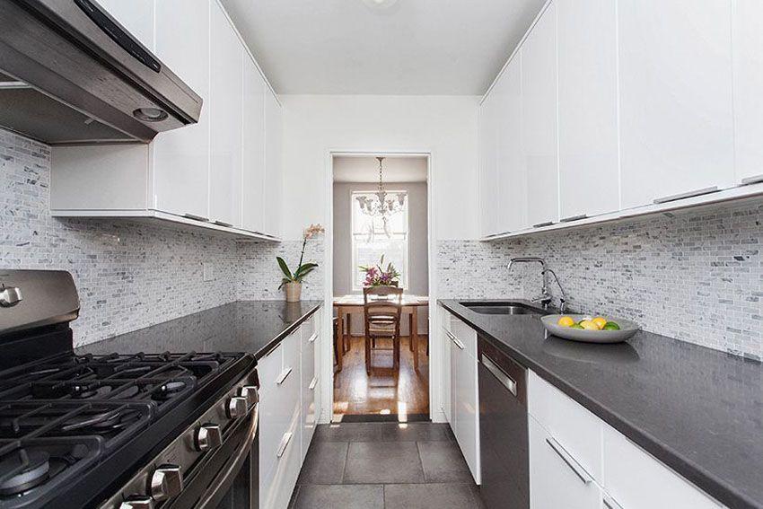 Small White Galley Kitchen With Black Corian Countertoposaic Tile Backsplash