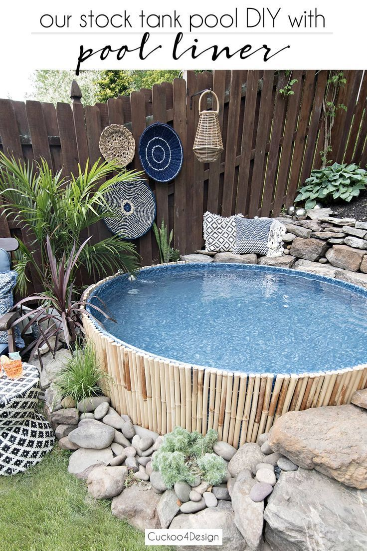 Our new stock tank swimming pool in our sloped yard