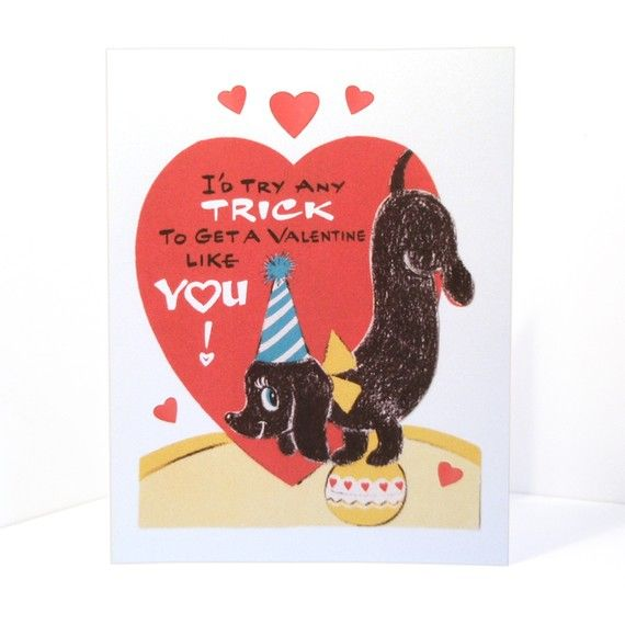 "A clever little dachshund who is standing upside down on a yellow ball. Behind the dog is a big red heart that says, ""I'd Try Any Trick To Get a Valentine Like You!"""