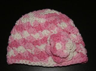 "This is an original pattern by me, I call it the Pink Sweet Pea Hat :)   It fits newborn - 3 months. The measurements are about 13.5""  aroun..."