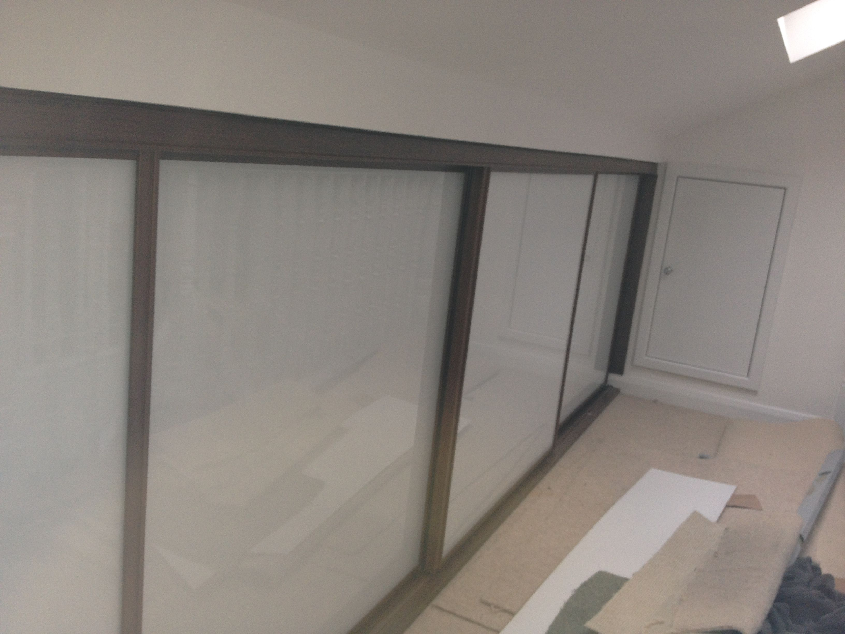 Loft Storage Sliding Doors In Loft Eaves In This Isleworth Loft Conversion By
