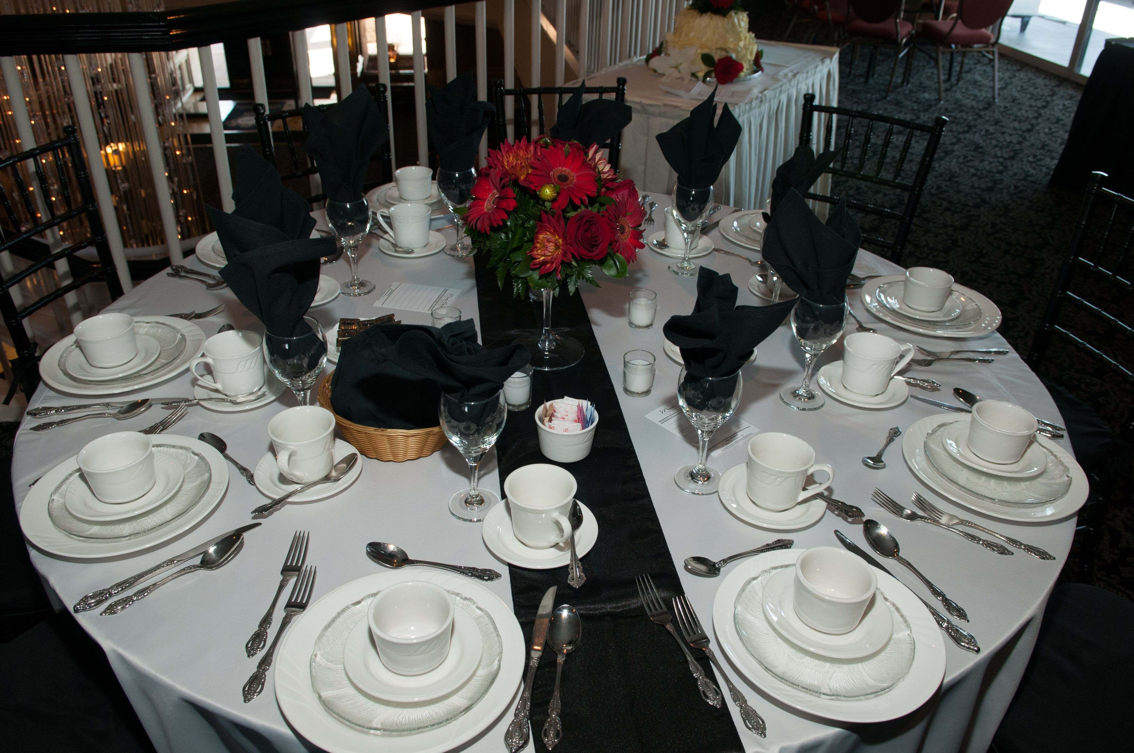Dinner tables with floor length tablecloths black runners and black