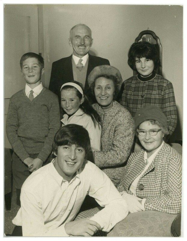 John Lennon with his uncle George, aunt Mimi and extended family. | The beatles, John lennon, John lennon beatles
