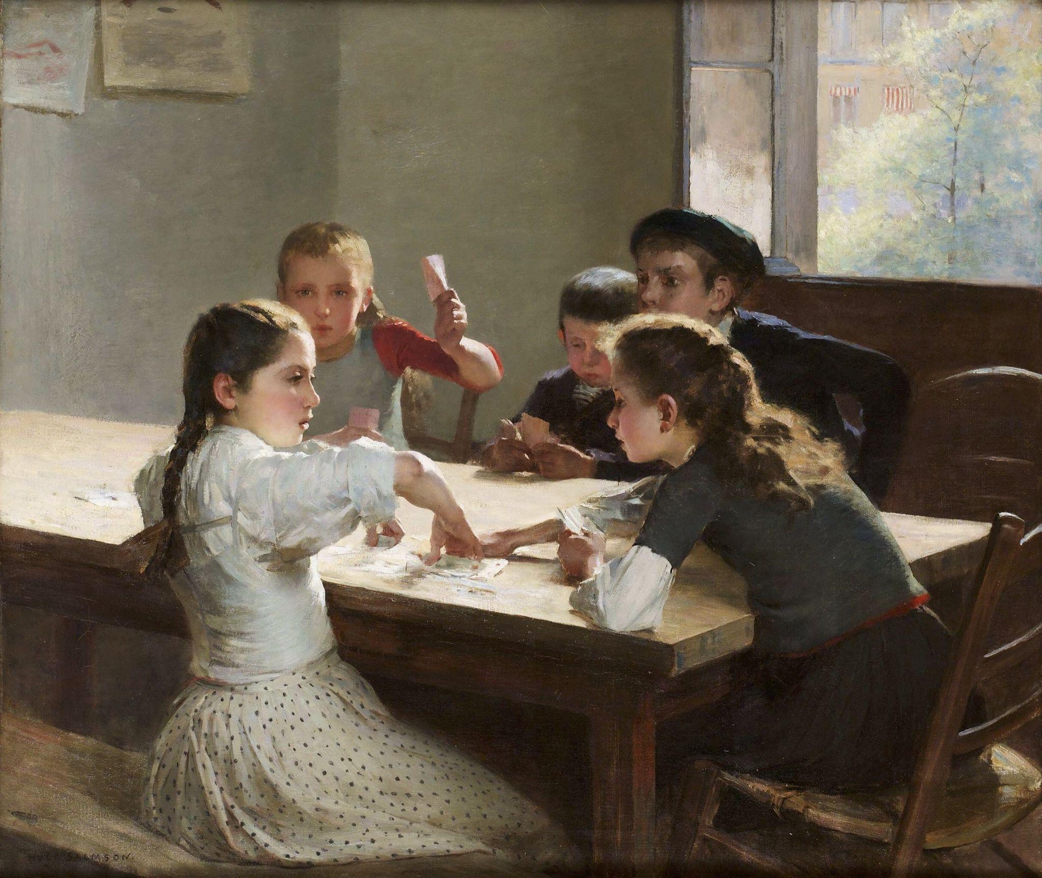 Niños jugando a las cartas\