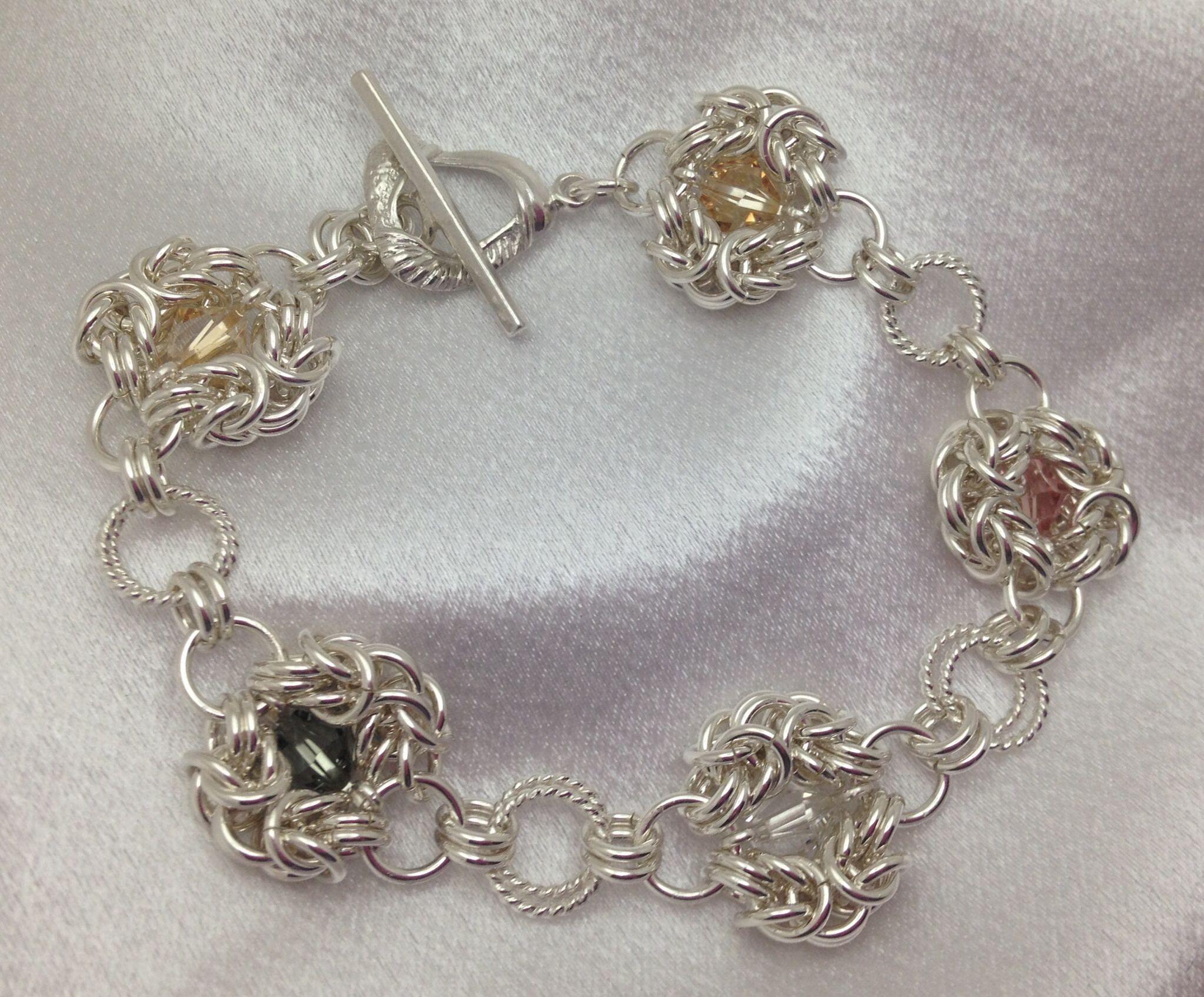 Sterling silver Romanov florets with Swarovski crystals bracelet.  www.Facebook.com/WireCrossing