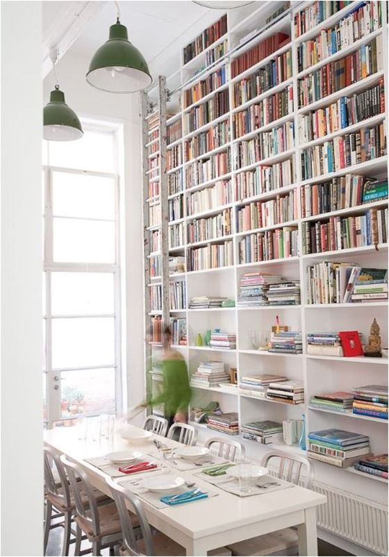 dining room bookshelves. bookcases decorated with actual books. Love the floor to ceiling books.