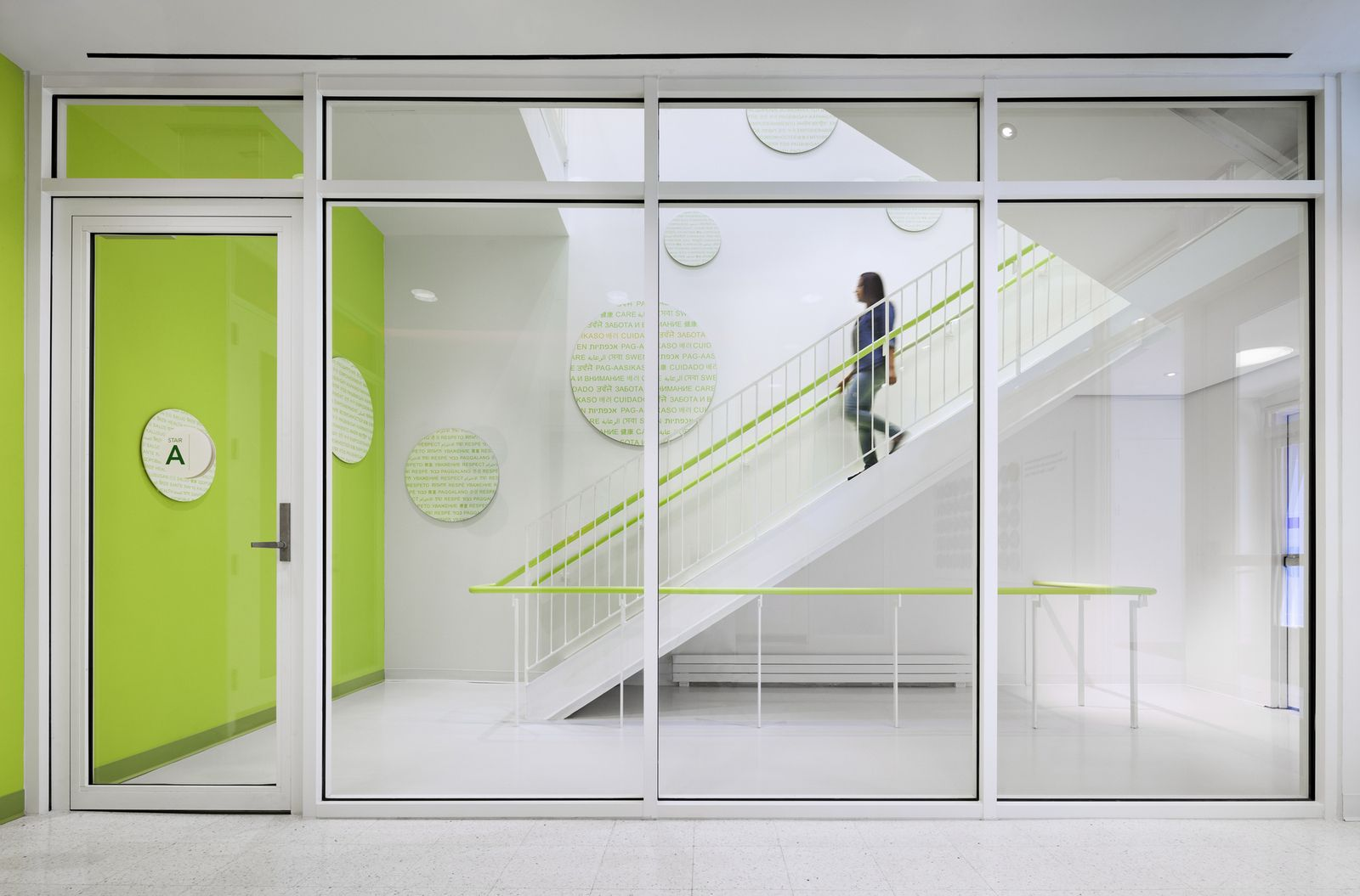 Fire rated glass office doors - Fire Rated Glass Natural Light And Colorful Graphics Transform Ordinary Fire Stairs Into