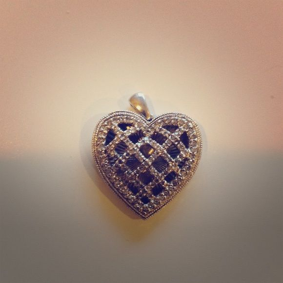 1/2 ct wt Diamond heart pendant in Sterling silver Affinity diamond 1/2 ct wt illusion heart pendant set in Sterling silver. The heart shaped pendant is accented with round bead-set diamonds over a textured disc, with openwork scroll design along the sides. QVC Jewelry Necklaces