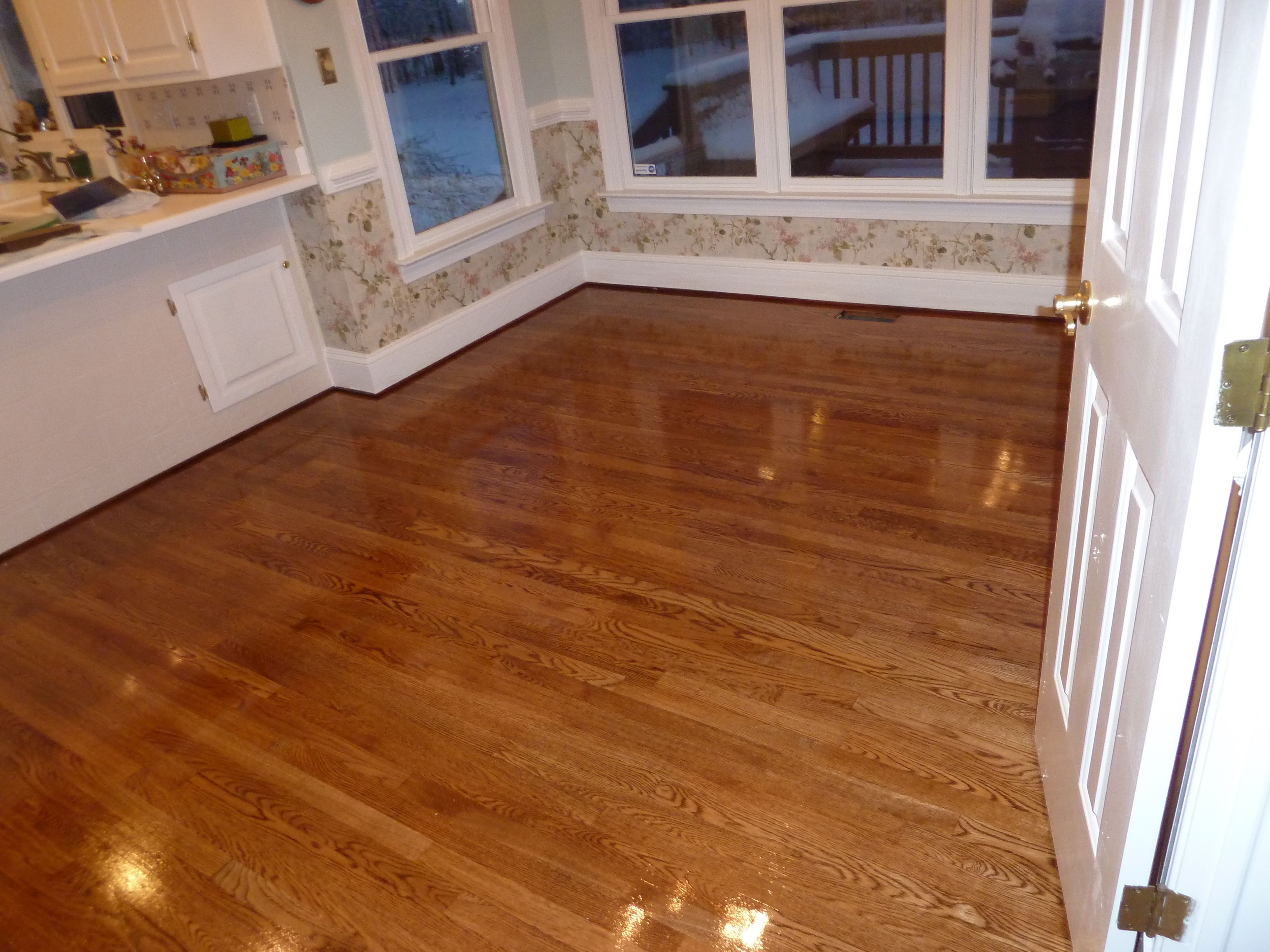 2 3 4 Red Oak Hardwood Flooring Stained Golden And Coated With A High Gloss Finish