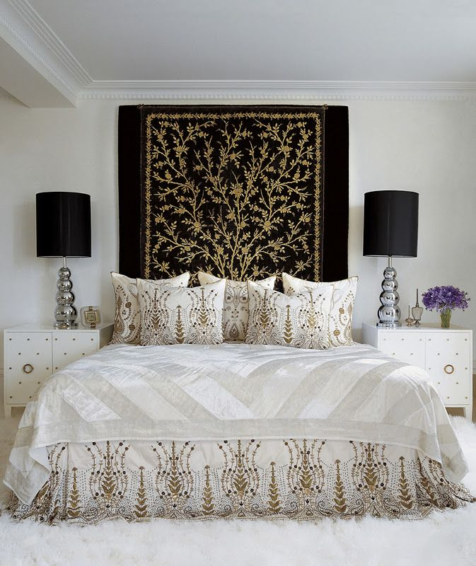 bedroom with black, gold, white, ethnic, oriental tapestry