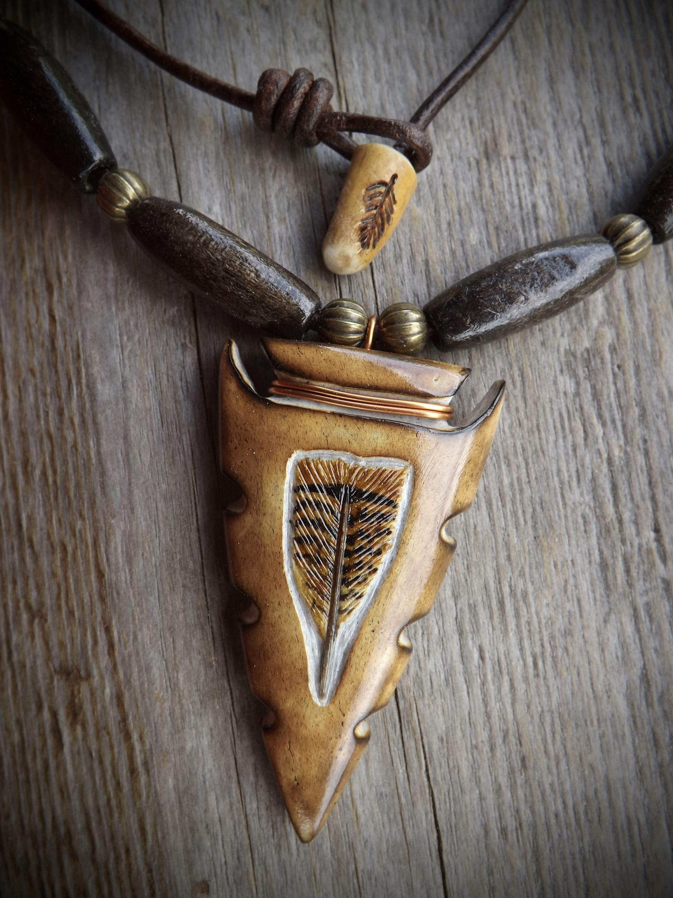 Hand carved from whitetail deer antler and strung on mm