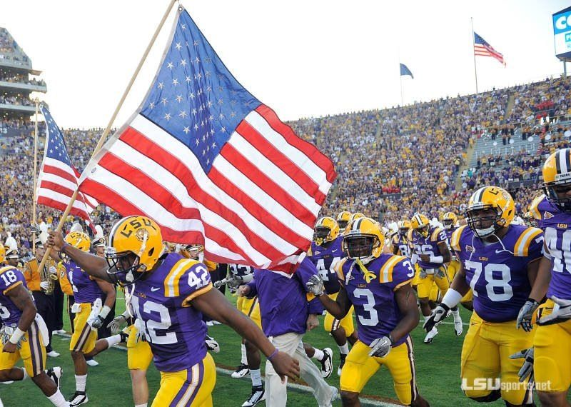 From Lsu Aw Man That S An Awesome Pic Our Tigers With The American Flag Great Colors Purple Gold And The Red Lsu Tigers Football Lsu Tigers Lsu Football