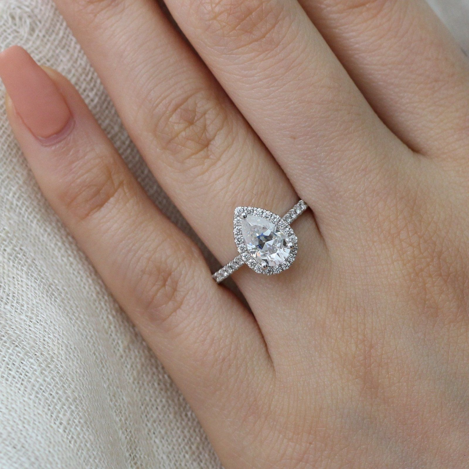 Luna halo ring in pave band w pear forever one moissanite and