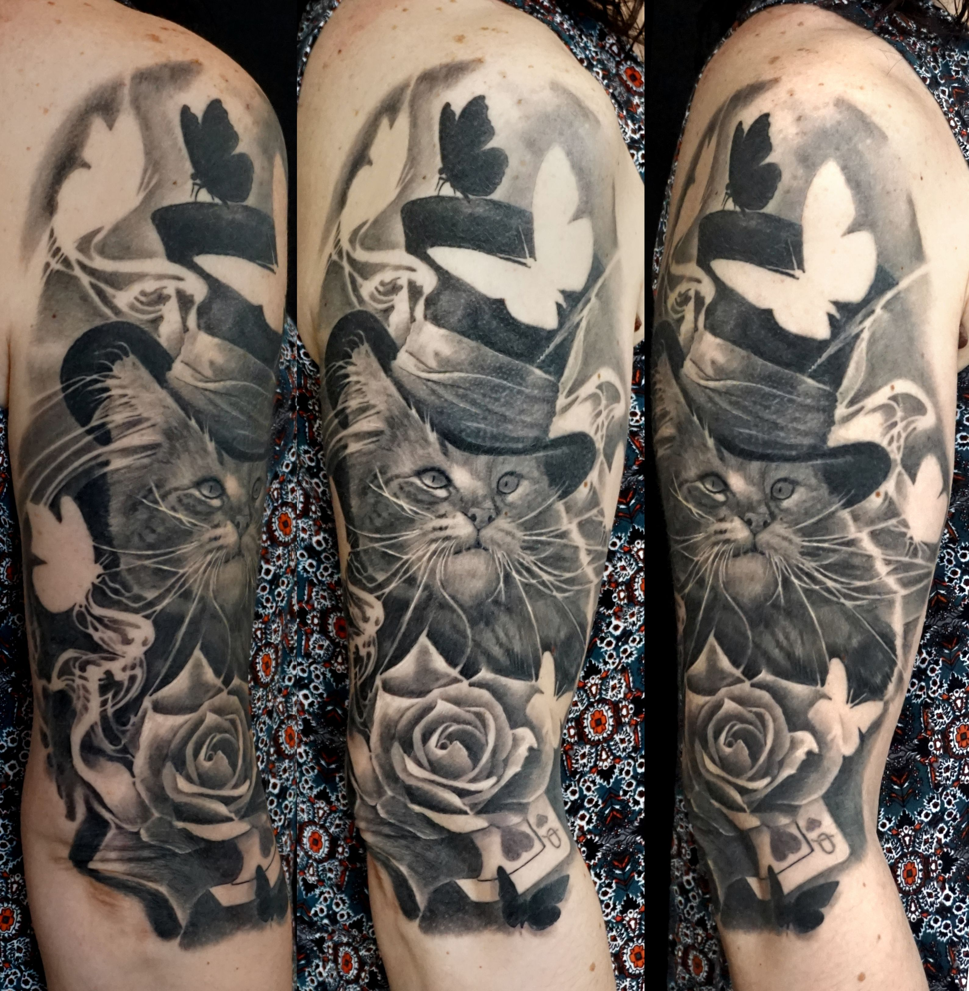 8cdf68fb0 Alo Loco Tattoo | HEALED Alice in Wonderland | Black and grey realism #halfsleeve  tattoo of a cat wearing hat surrounded by #butterflies #rose smoke ...