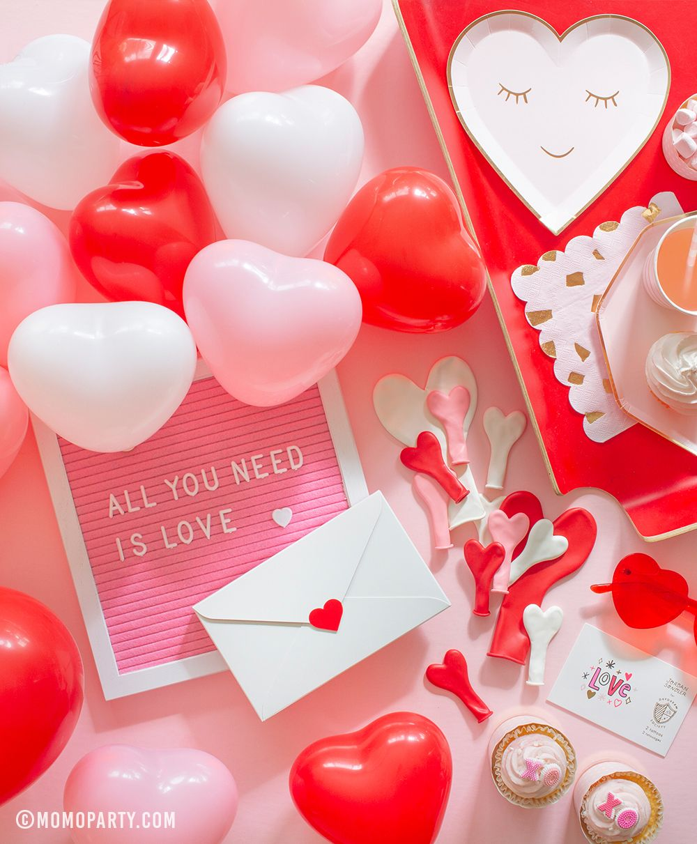 A table with adorable party goods for your Valentine's Day or Galentine's Day celebration. Check out momoparty.com for more! #galentinesday #valentines #valentinesdaybrunch