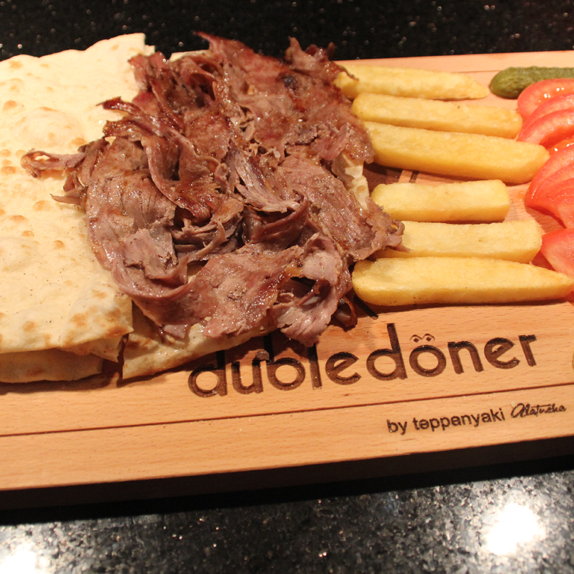 Doner kebab is a Turkish dish made of meat cooked on a vertical rotisserie, normally lamb but also a mixture of veal or beef with these..The sliced meat of a Doner kebab may be served wrapped in a flatbread such as lavash or pita or as a sandwich instead of being served on a plate