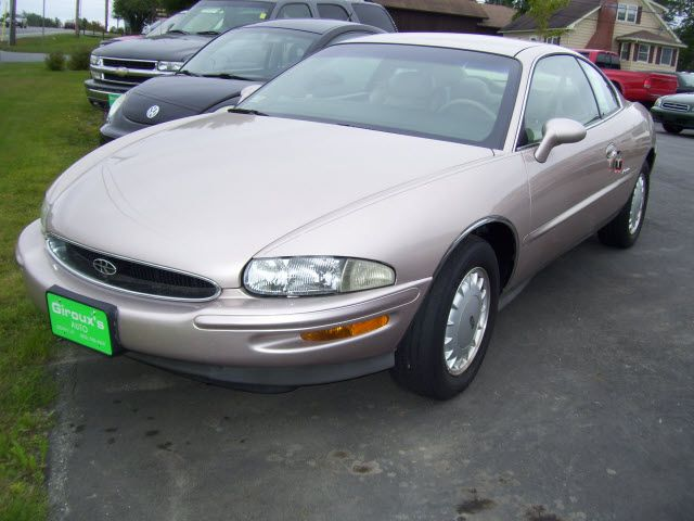 The 1995 99 Buick Riviera Models Bore Absolutely NO RESEMBLANCE To Its Fore Fathers All Styling Cues Of Bill Mitchell Designs Were Gone For Good