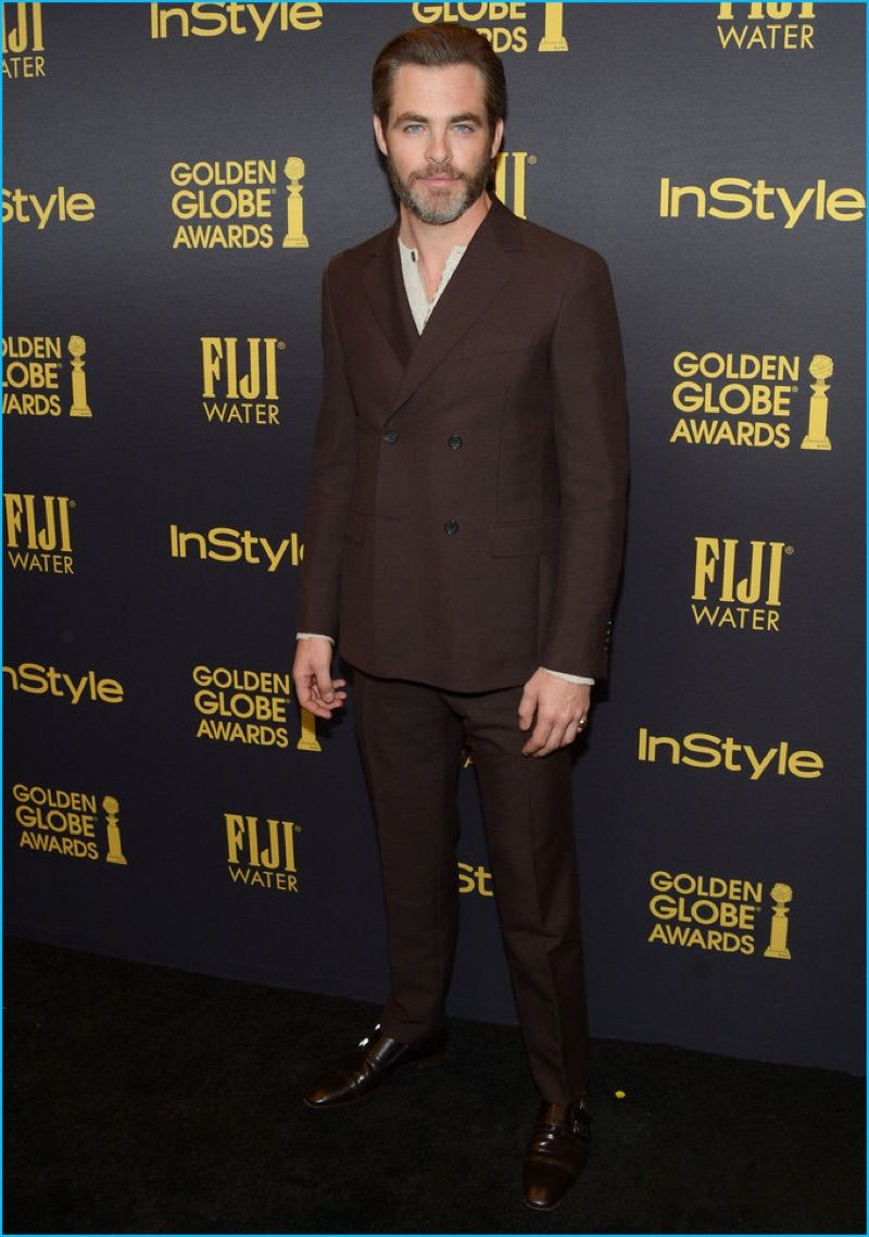 93b79e24e75e35 Chris Pine wears a double-breasted brown suit from Salvatore Ferragamo's  fall-winter 2016 collection.