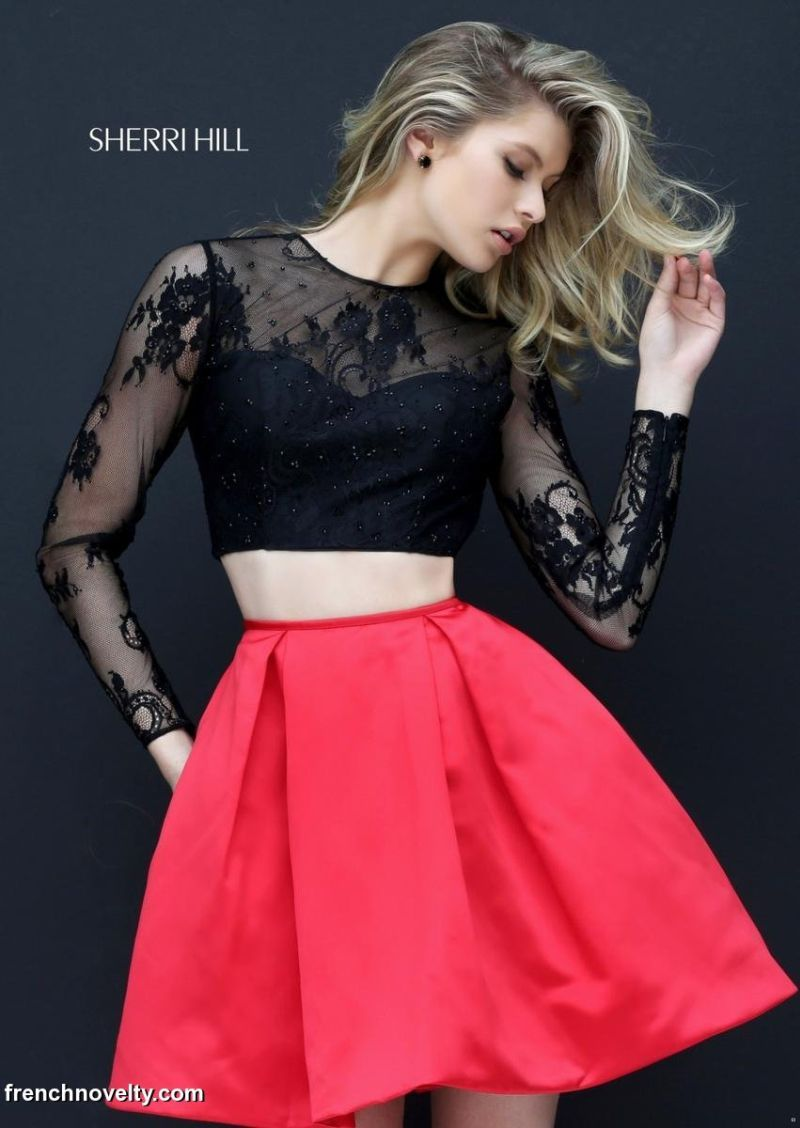 22cff3a4355 Sherri Hill 50533 is a long-sleeved, two-piece short party dress with sheer  lace sleeves, a full skirt and a sweetheart neckline.