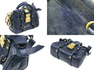 Tiny MiuMiu keychain handbag. The details are AMAZING