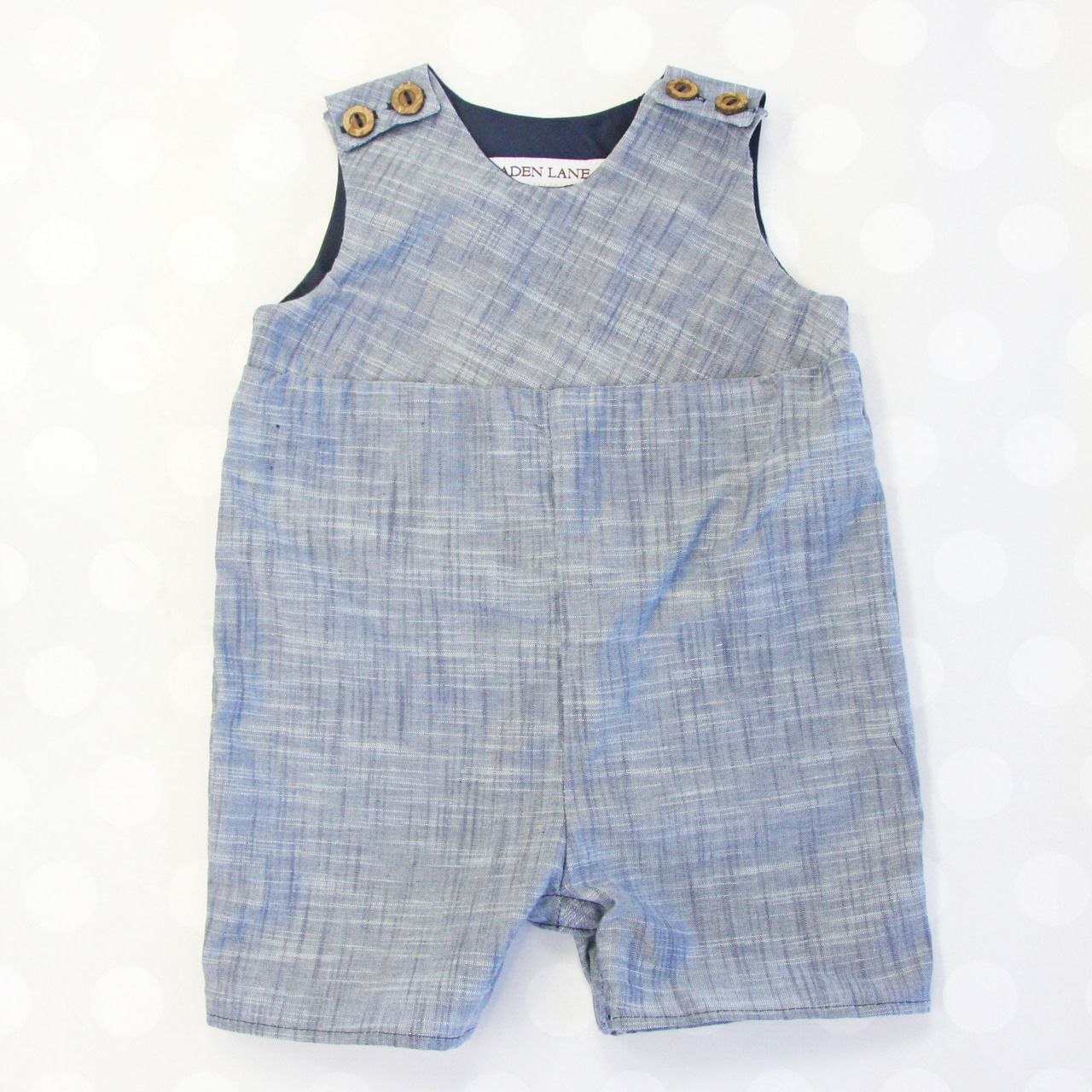 71e69e326c2f This little boy s chambray romper is simple and classic in a way ...