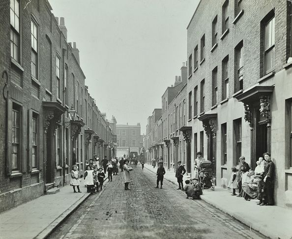 People in the street Albury Street Deptford London 1911 Street of twostorey Georgian terraced houses with elaborate carvings above the doors People...