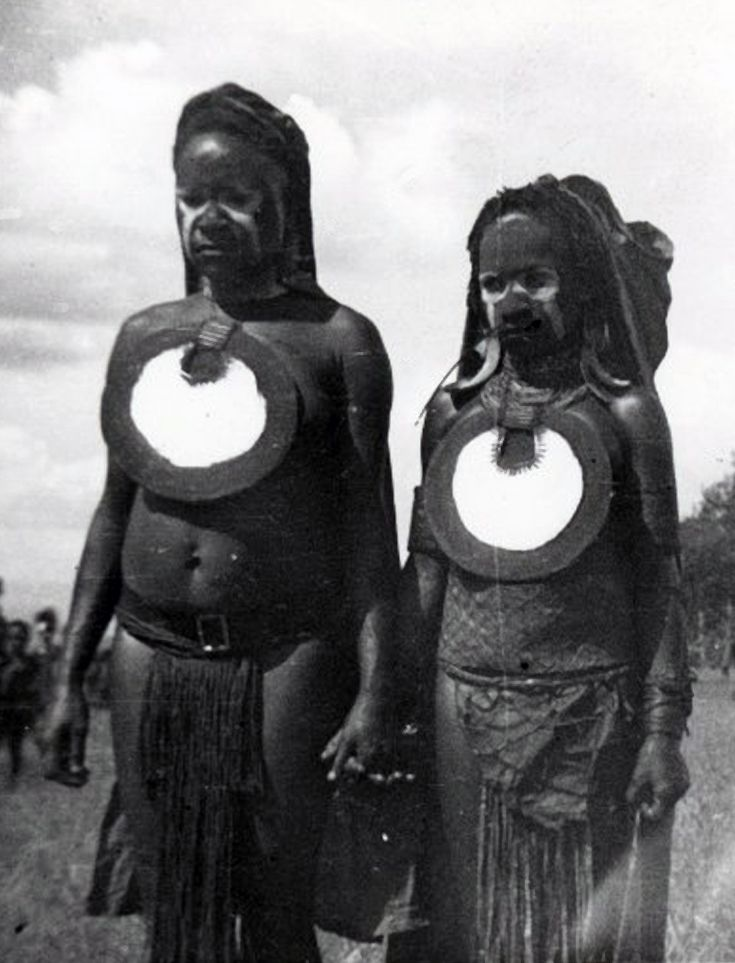 Papua New Guinea   Two women holding hands, wearing bilum ...