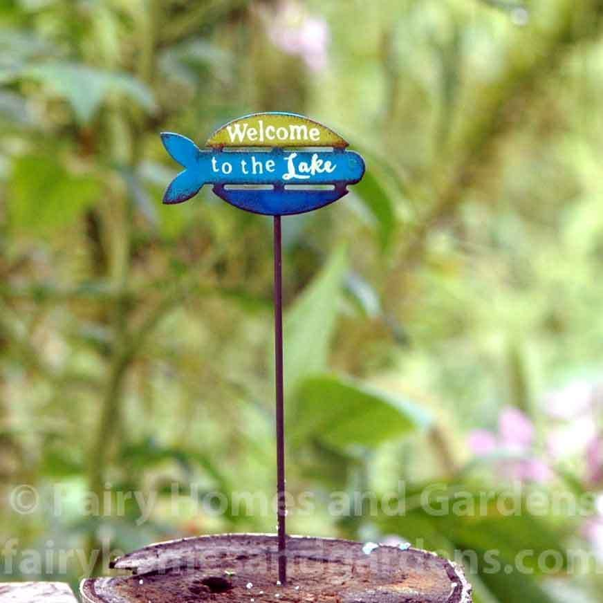 Miniature  Welcome to the Lake  Sign is part of Fairy garden Signs - This miniature  Welcome to the Lake  sign is made of metal with allweather paint   It is from the Gypsy Fairy Garden Collection, but would be a lovely addition to your summer camp themed miniature garden