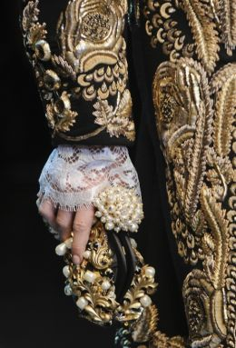 baroque details, winter 2012 Dolce and Gabbana. heavy antique gold embroidery and appliqué.
