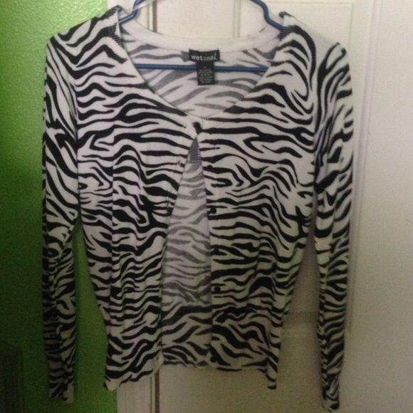Zebra Print Cardigan. Full sleeve zebra print cardigan. Never been worn. Waist length. Wet Seal Jackets & Coats