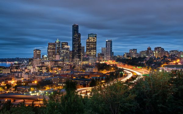 """Downtown Seattle After arriving in Seattle, I immediately went to this spot to grab a photo.  I barely made it in time.  I had about 30 minutes of full light left before this scene began.  It gave me just enough time to set up and frame everything with the right settings.  I guess """"last minute"""" sound a little dramatic, but, really, for me, I like to have some extra time to make sure all my settings are right before that magic moment hits.  - Trey Ratcliff  The rest of this entry and a new…"""