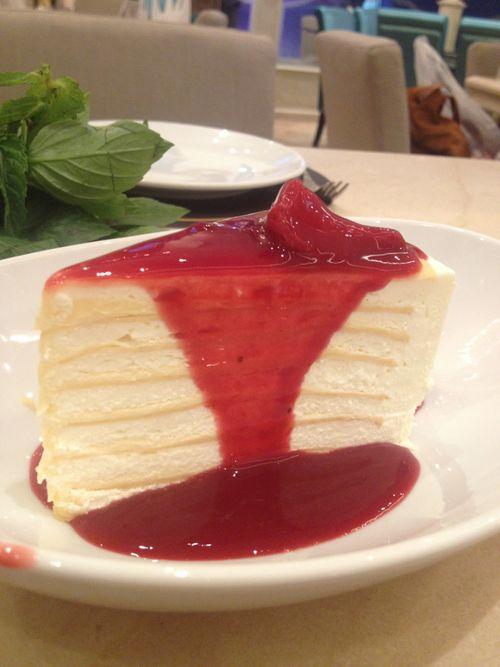 Vanilla crepe cake with strawberry sauce