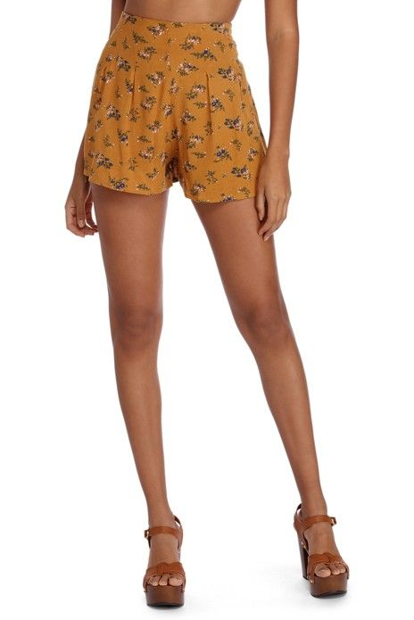 6f10988a1 Be a vision in floral in these beautiful printed flowy shorts! They feature  a high waist fit, a back zipper and fish hook closure, pleated details, and  a